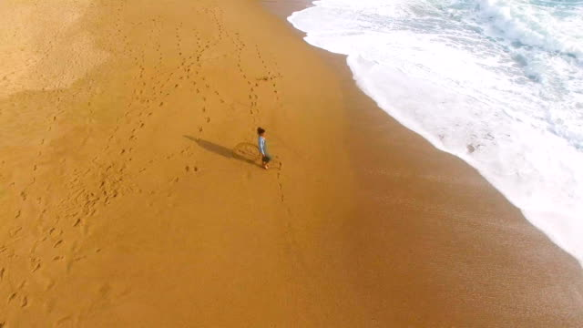 aerial view of a woman alone in an amazing and unspoiled beach in the spain coast - camel stock videos & royalty-free footage