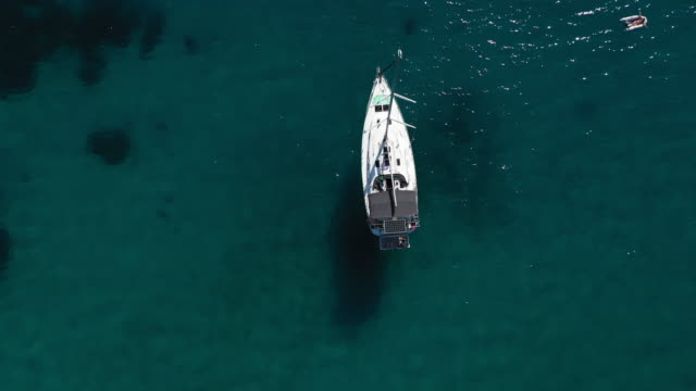 aerial view of a yacht on ionian sea - island stock videos & royalty-free footage