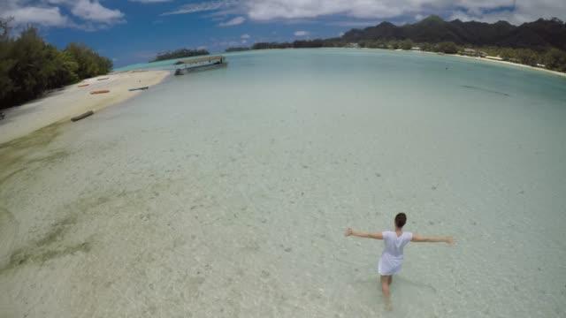 aerial view of a young woman enjoying muri lagoon in rarotonga cook islands - rarotonga stock videos & royalty-free footage