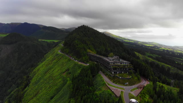 vidéos et rushes de aerial view of abandoned hotel on top of viewpoint in the volcano crater at the azores islands. - îles de l'atlantique