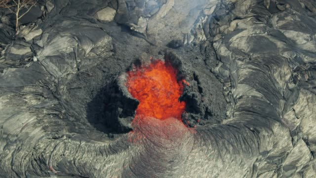 Aerial view of active volcanic activity destroying trees