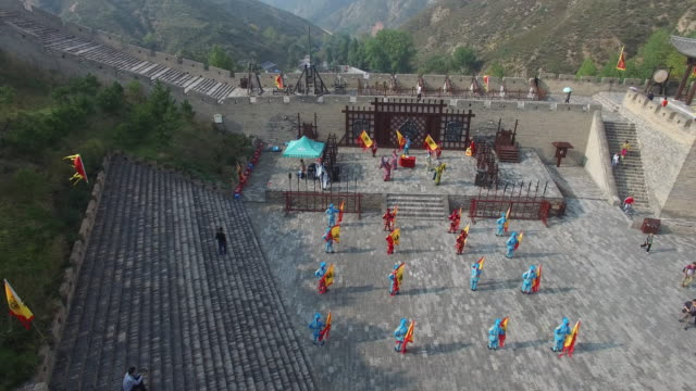 Aerial view of actors dancing beside of Yanmen Pass, great wall's most important pass, China