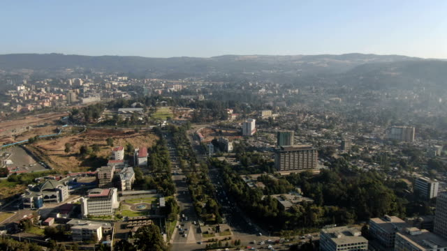 aerial view of addis ababa city center with unity park, emperor's palace compound/ ethiopia - アジスアベバ点の映像素材/bロール