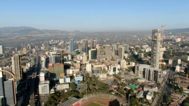 vídeos de stock e filmes b-roll de aerial view of addis ababa skyline and city center with tall buildings and downton/ ethiopia - africa