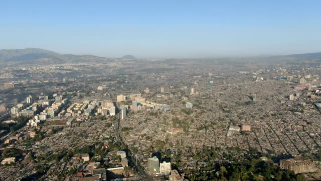 aerial view of addis ababa skyline and sprawling urban city with cityscape and downton/ ethiopia - アジスアベバ点の映像素材/bロール