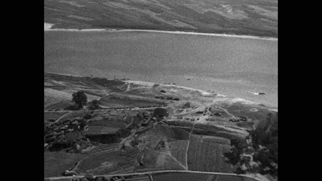 aerial view of agricultural field by river, korean war - aircraft point of view stock videos & royalty-free footage