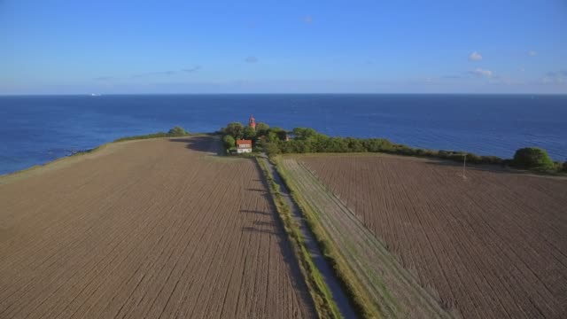 aerial view of agriculture field and lighthouse staberhuk on the island fehmarn - schleswig-holstein , germany - schleswig holstein stock videos & royalty-free footage