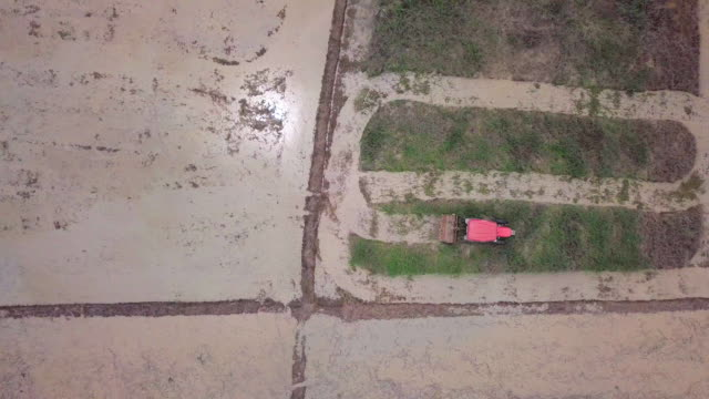 aerial view of agriculture machine working on farming area - plowing stock videos & royalty-free footage