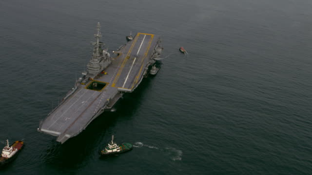 aerial view of aircraft carrier. - aircraft carrier stock videos & royalty-free footage