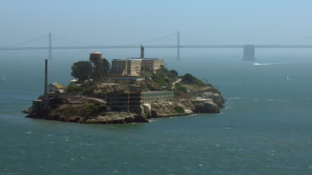 aerial view of alcatraz island in san francisco - alcatraz island stock videos & royalty-free footage