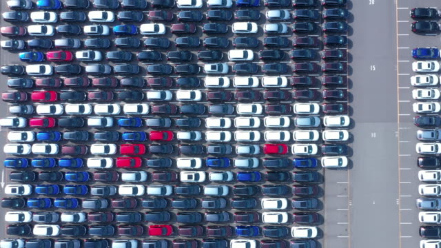 aerial view of aligned cars in industrial harbor - part of a series stock-videos und b-roll-filmmaterial