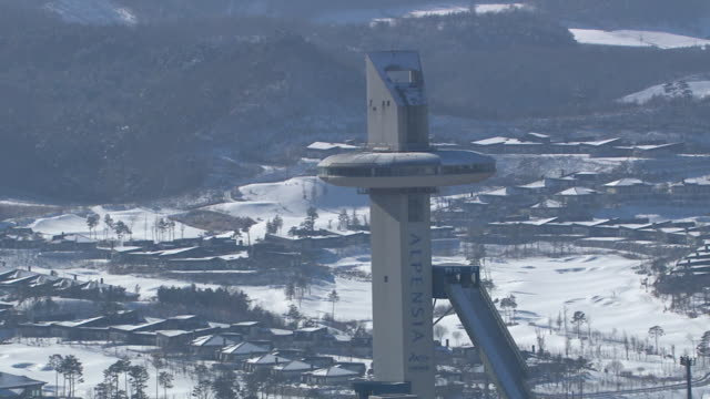 aerial view of alpensia ski jumping stadium of pyeongchang (2018 winter olympics) in distance - ski jumping stock videos and b-roll footage