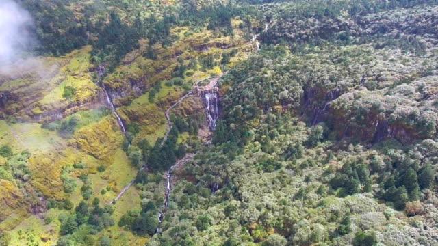 aerial view of amazing waterfall along beautiful green mountain, jiaozi mountain, yunnan province, china - yunnan province stock videos and b-roll footage