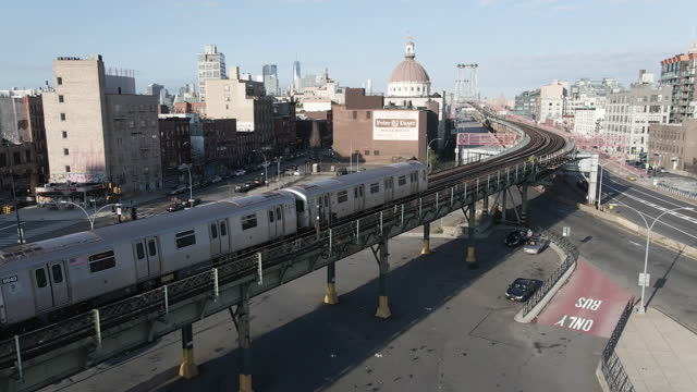 aerial view of an above ground subway train passing through brooklyn, new york - brooklyn new york stock videos & royalty-free footage