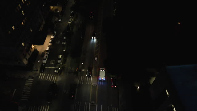 aerial view of an ambulance driving through brooklyn at night. - night stock videos & royalty-free footage