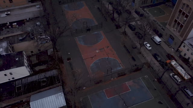 vídeos de stock, filmes e b-roll de aerial view of an empty basketball court - court