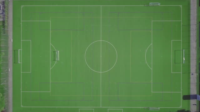 aerial view of an empty grass  soccer field - football pitch stock videos & royalty-free footage
