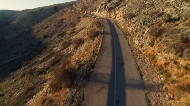 aerial view of an empty road at late afternoon on island krk - ripido video stock e b–roll