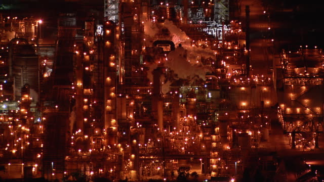 Aerial view of an oil refinery in Carson, California, at night.