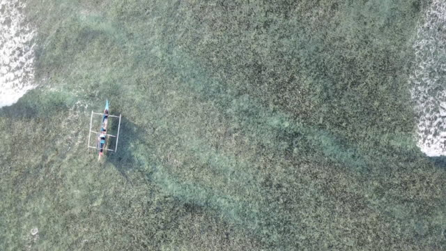 aerial view of an outrigger boat - south east asia stock videos & royalty-free footage