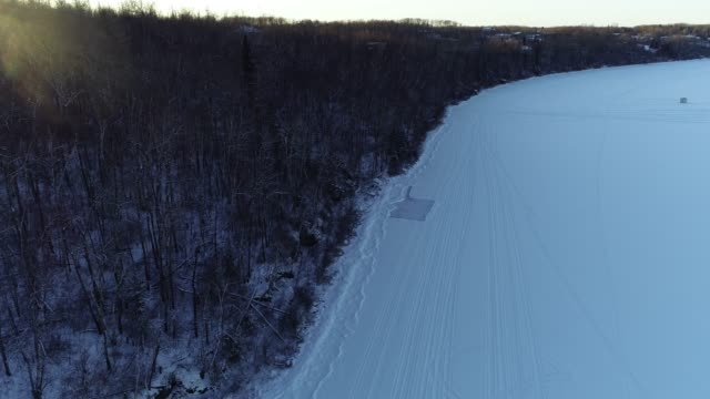 aerial view of an skating rink on a frozen lakeshore - ice rink stock videos & royalty-free footage