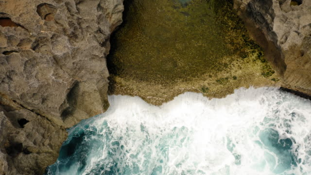 aerial view of angel billabong, nusa penida, indonesia - island stock videos & royalty-free footage