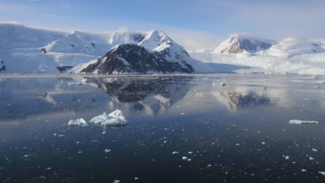 aerial view of antarctic peninsula, mountains and sea - water surface stock videos & royalty-free footage