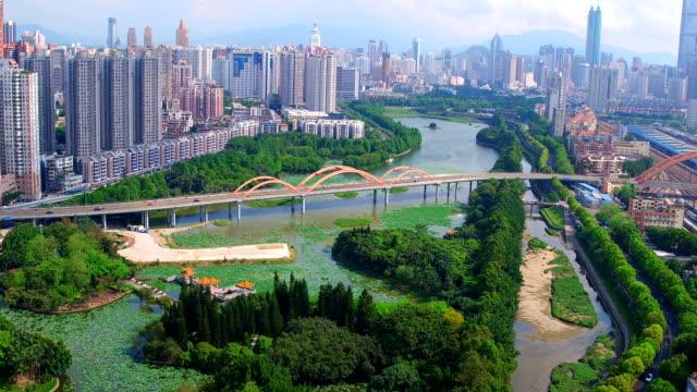 aerial view of arch bridge in shenzhen - arch bridge stock videos & royalty-free footage
