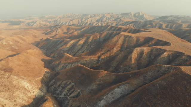 aerial view of arid landscape - terra brulla video stock e b–roll
