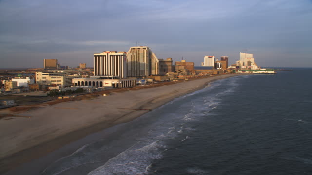 vídeos de stock, filmes e b-roll de aerial view of atlantic coast by boardwalk area of atlantic city. shot in 2011. - artbeats