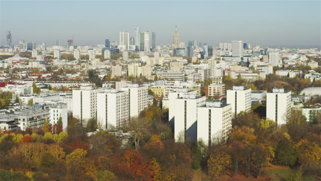 aerial view of autumnal warsaw. residential area and historical buildings seen from above. distant skyline in background - warsaw stock videos & royalty-free footage