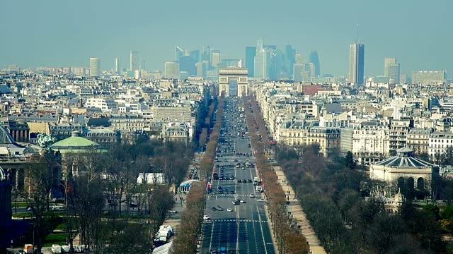 aerial view of avenue of champs elysées and surrounding buildings including arc de triomphe monument with la défense financial district in the... - avenue des champs elysees stock videos & royalty-free footage