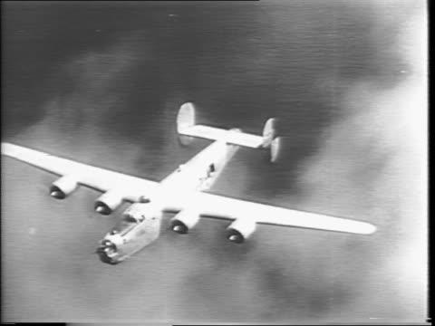 stockvideo's en b-roll-footage met aerial view of b24's flying being attacked by japanese fighter planes / bomber's left wing is hit and dislodged in air plane goes down / aerial view... - tweede wereldoorlog in azië