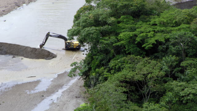 aerial view of backhoe digging at illegal gold mine, colombia - medellin colombia stock videos & royalty-free footage