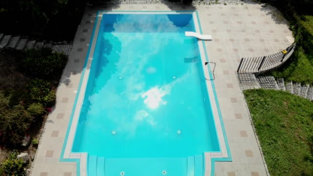 aerial view of backyard with large swimming pool - lido stock videos & royalty-free footage