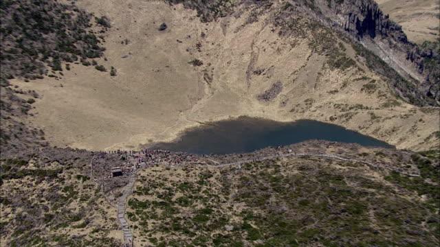 Aerial View of Baengnokdam Crater Lake (Hallasan mountain peak) with mountain climbers