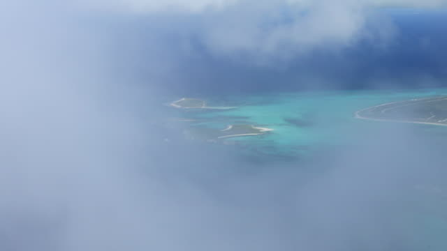 aerial view of bahamas through wispy clouds - wispy stock videos and b-roll footage