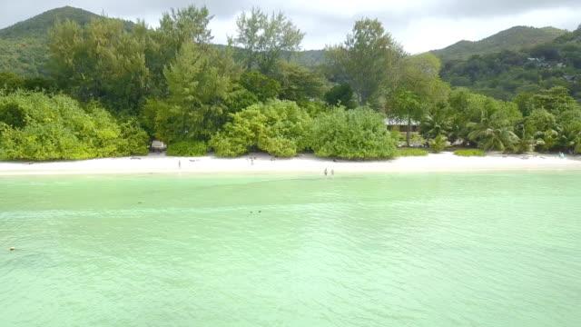 stockvideo's en b-roll-footage met luchtfoto van baie sainte anne - praslin - seychellen - pjphoto69