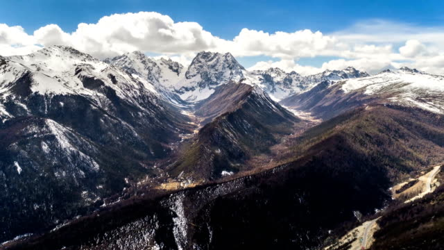 aerial view of baima snow mountain - time lapse - yunnan province stock videos and b-roll footage
