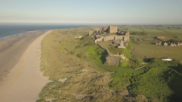aerial view of bamburgh castle and beach, northumberland, england, united kingdom, europe - england stock-videos und b-roll-filmmaterial