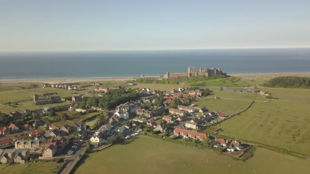 aerial view of bamburgh castle with north sea in background, northumberland, england, united kingdom, europe - northumberland video stock e b–roll