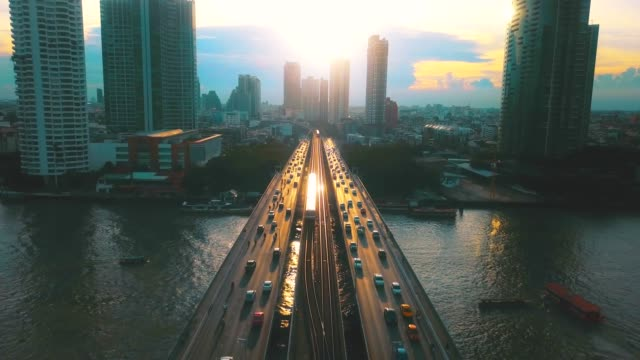 vídeos de stock e filmes b-roll de aerial view of bangkok at sunset - transportation