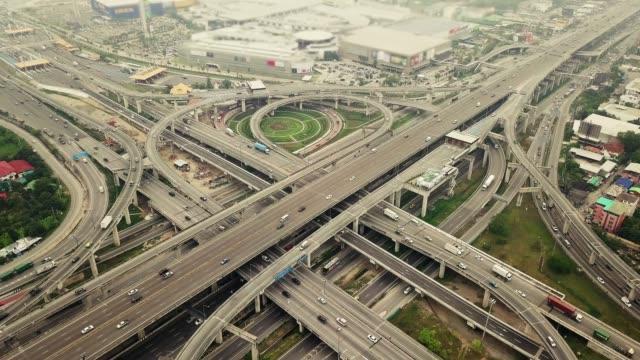 4k: aerial view of bangkok highway - economy stock videos & royalty-free footage