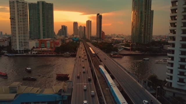 Aerial view of bangkok riverside downtown at sunset