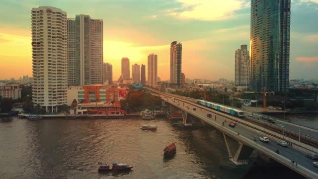 Aerial view of bangkok riverside downtown at sunset