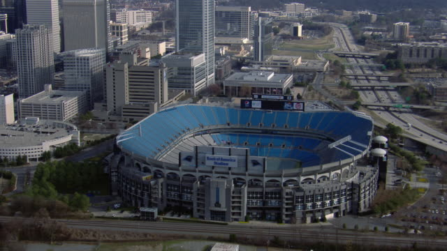 aerial view of bank of america stadium in downtown charlotte, north carolina, united states of america. - western script stock videos & royalty-free footage