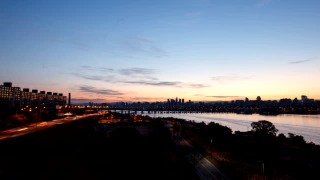 Aerial view of Banpo bridge over Han River and Gangbyeonbukno at sunrise
