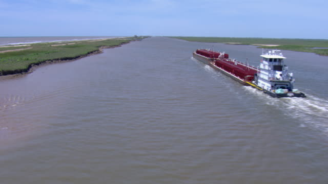 aerial view of barge in intracoastal waterway in matagorda county, texas. - barge stock videos & royalty-free footage