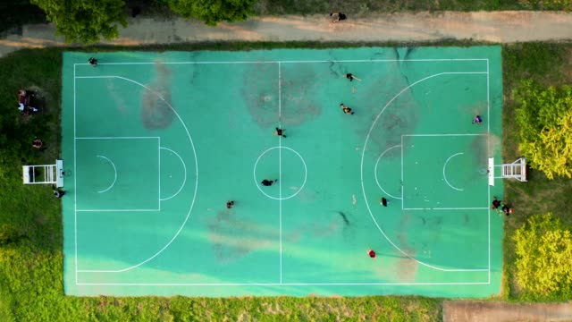 aerial view of basketball court during sunny day - aerial stock videos & royalty-free footage