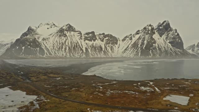 aerial view of bay at vestrahorn mountains - iceland stock videos & royalty-free footage